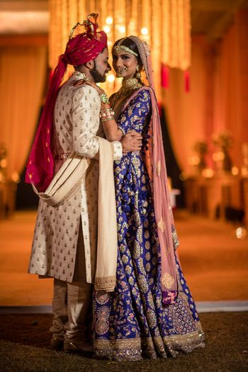A gorgeous couple shot, with bride in purple lehenga!