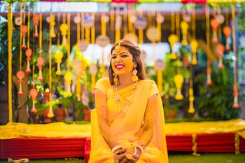 A happy bride on her haldi ceremony!