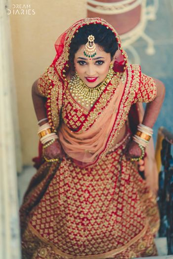 Photo of Bright Red and Gold Lehenga