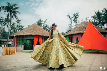 Photo of Twirling bride to be in floral lehenga on mehendi day
