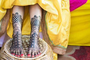 A bride with her feet decorated with mehendi