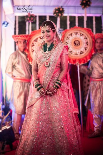 Photo of Peach sparkly bridal lehenga