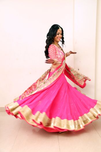 Photo of Fuchsia Pink Twirling Lehenga with Gold Border