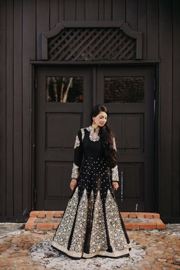 Photo of Black anarkali with silver motifs