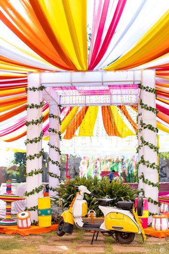 Photo of Colorful mehendi decor with drapes and props