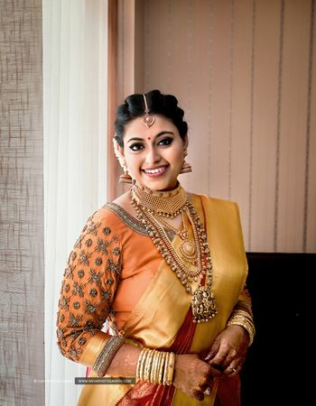 A south indian bride in a kanjeevaram and gold jewelry!