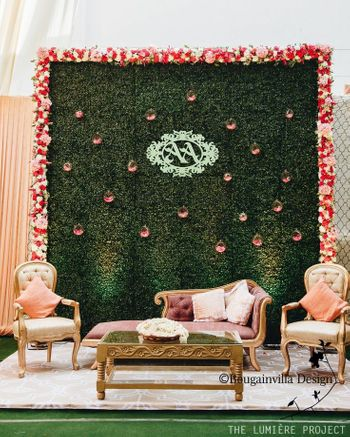 Stage decor with a botanical wall backdrop