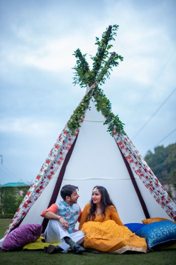 Photo of A minimal tepee tent decor at a mehendi