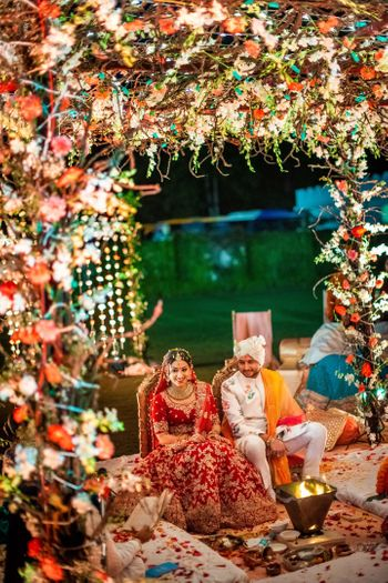 Photo of A couple at their floral mandap