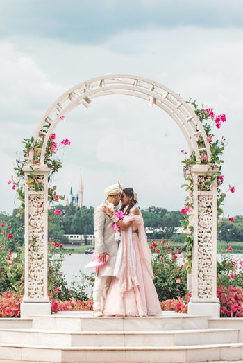 Photo of Intimate wedding couple portrait in pastels