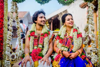 A south Indian couple with brightly colored outfits