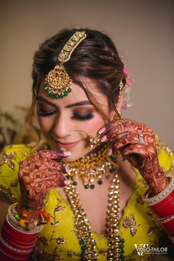 A bride in unique polki and jadau jewelry