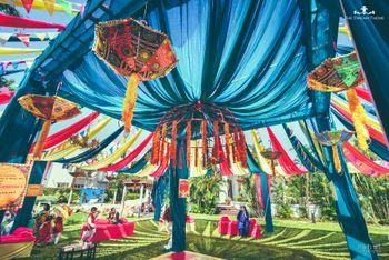 Photo of Mehendi decor idea with blue theme and hanging umbrellas