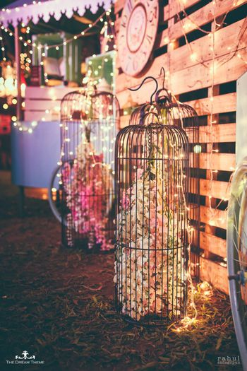Giant birdcage with flowers inside