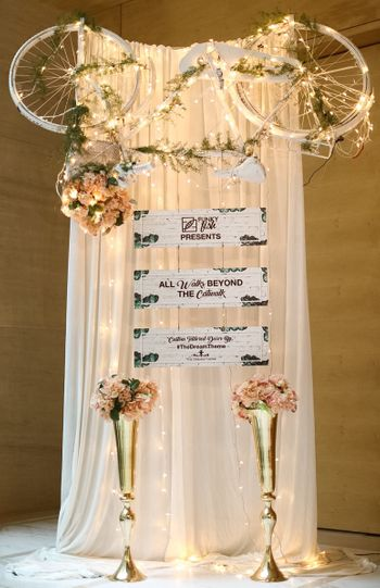 Pastel Decor Prop with Upturned Cycle and Florals
