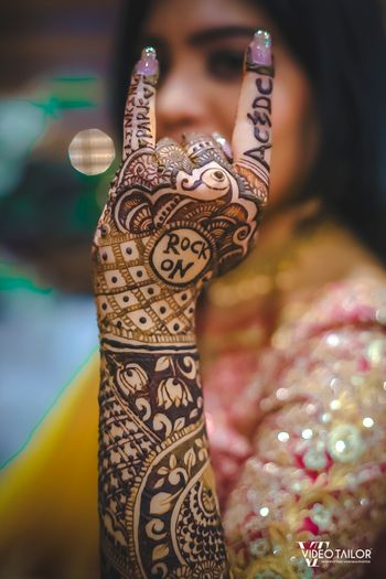 Unique bridal mehendi design with rock bands