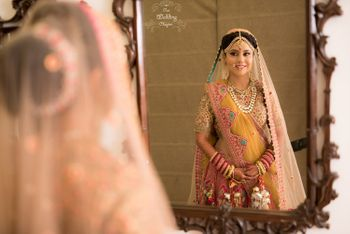 Photo of Bride Looking Through The Mirror
