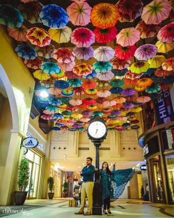 Pre wedding shot with umbrellas in ceiling