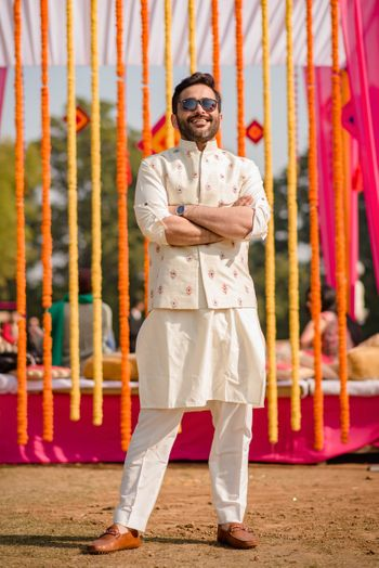 Mehendi groomwear with off white nehru jacket