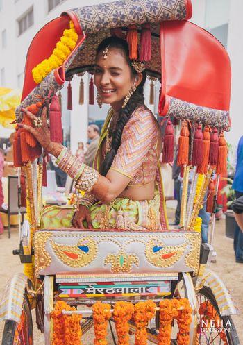 Mehendi fun bridal portrait with bride sitting on rickshaw