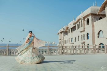 Twirling bride in an offbeat bridal lehenga with a pop of blue