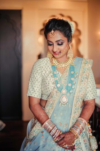 Offbeat bridal lehenga in light blue and white