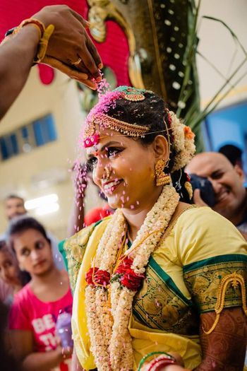 A south indian bride during one of the wedding rituals