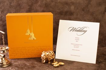 Photo of Yellow wedding card box with bells