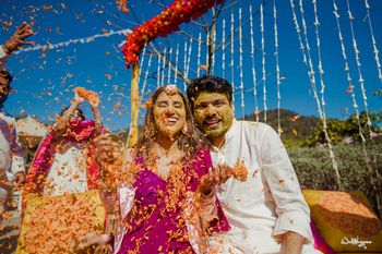 Photo of fun haldi couple portrait