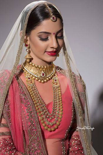 Photo of Simple bridal look with matte brown eyes and red lips