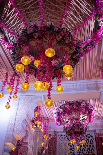 Hanging pink floral chandelier with lights