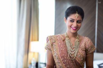 Smiling Bride Wearing Peach Lehenga Portrait