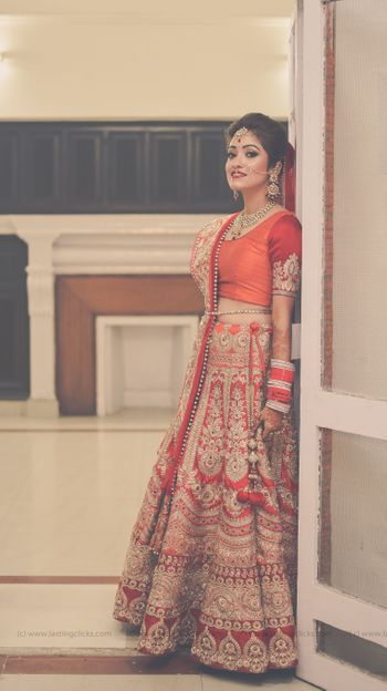 Orange and Red Lehenga with Zari Work