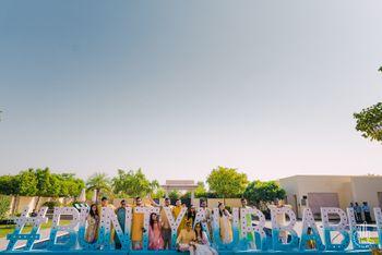 Giant wedding hashtag photobooth idea for pool party or mehendi