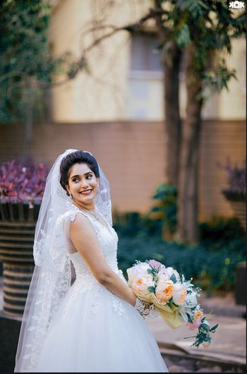 White Net Wedding Gown with Floral Bouquet