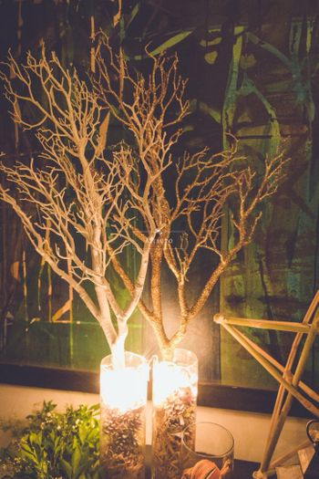 Photo of Dim Light Candles with Dry Trees Decor