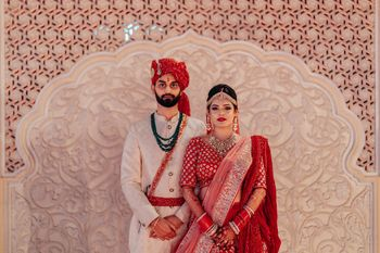 An adorable couple on their wedding in stunning outfits.