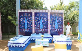 Photo of Mehendi printed backdrop idea in shades of blue