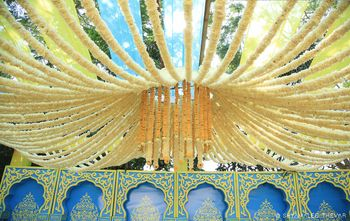Photo of Floral mandap decor idea with hanging floral strings