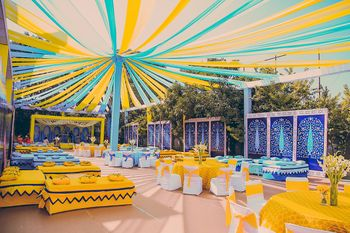 Photo of Light blue and yellow theme mehendi decor seating and tent idea