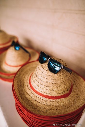 Hats and sunglasses as favours for summer wedding
