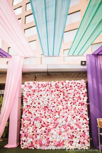 Floral wall decor idea with saying and drapes