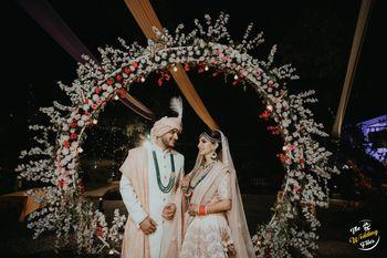 Couple portrait against floral archway