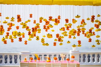 Yellow and orange hanging floral string decor idea