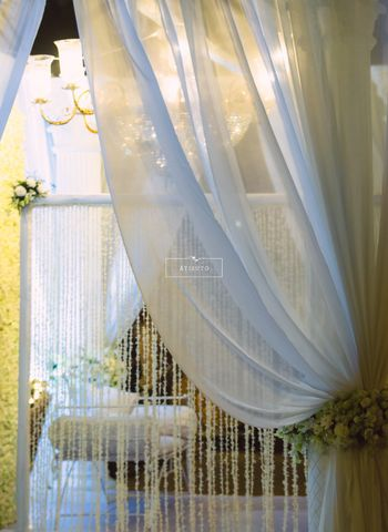 White Curtain Drapes with Floral Decor