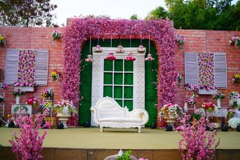 Engagement floral stage decor idea in pink