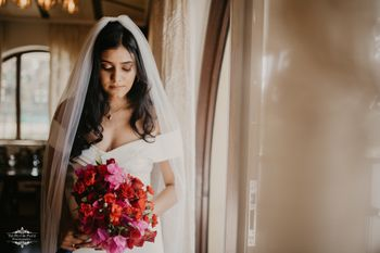 Christian wedding bride holding a red bouquet