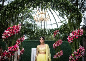 A to-be-married girl poses in a yellow lehenga for her mehendi