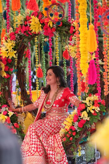 A bride in red for her mehndi