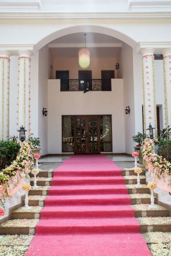 Photo of Red Carpet Entrance with Floral Decor